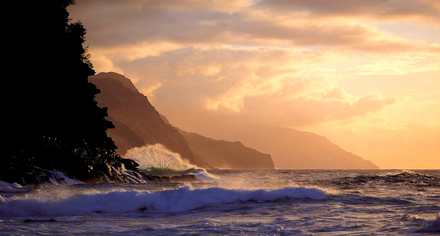 View of the Na Pali Coast, with waves breaking at Ke'e Beach, on the North-West coast of Kauai